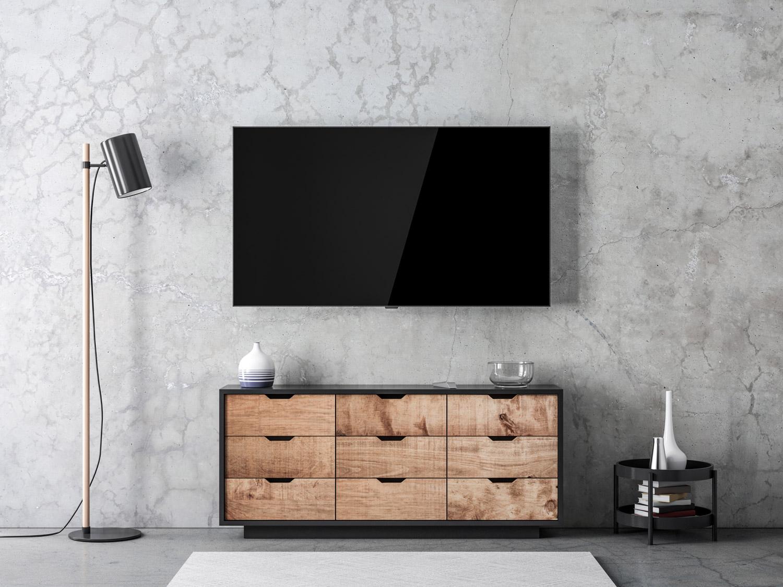 Betonowa ściana za telewizorem